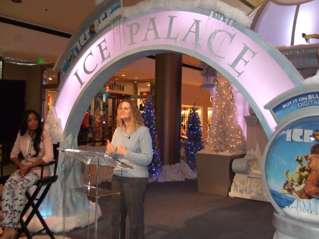 GLAD Inc.'s PR Assistant, Elizabeth Lutrell, explains to the press the mission of GLAD Inc. during press event at Beverly Center.