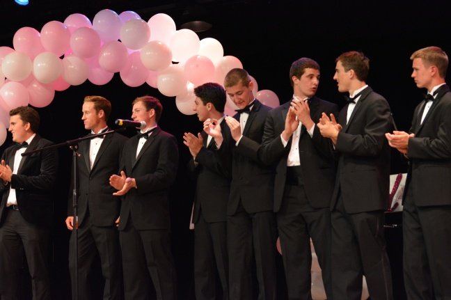 Male volunteers dressed up in tuxes and escorted the girls on stage. Credit: Rachel Quock, '15