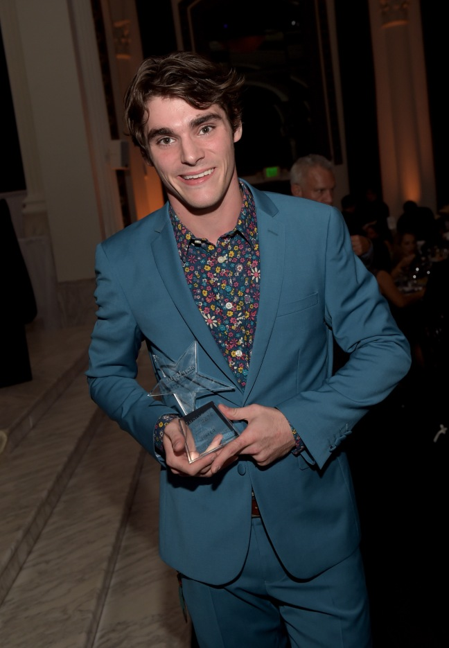 LOS ANGELES, CA - OCTOBER 23:  Honoree RJ Mitte poses with the Starbright World Inspiration Award at the 2014 Starlight Awards at Vibiana on October 23, 2014 in Los Angeles, California.  (Photo by Jason Kempin/Getty Images for Starlight Children's Foundation)