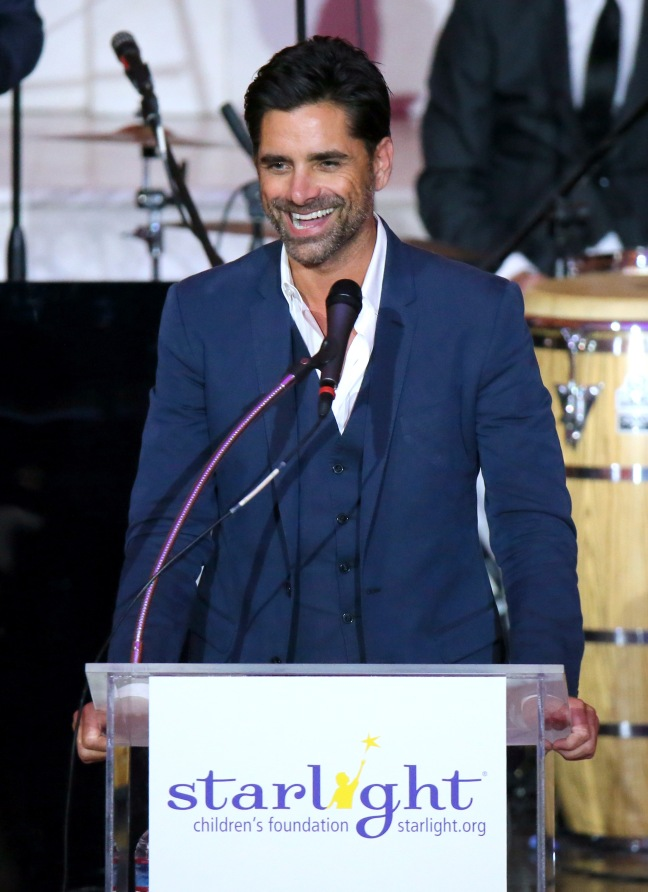 LOS ANGELES, CA - OCTOBER 23: John Stamos speaks onstage at the 2014 Starlight Awards at Vibiana on October 23, 2014 in Los Angeles, California. (Photo by Jason Kempin/Getty Images for Starlight Children's Foundation)